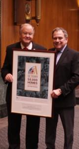 Representative Farr and South County Housing President Dennis Lalor.